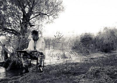 man bayou sitting